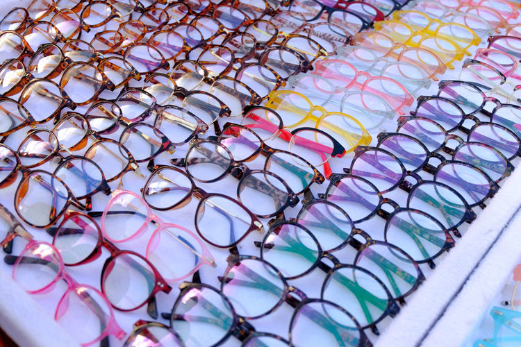 High angle view of multi colored eyeglasses on table at stall