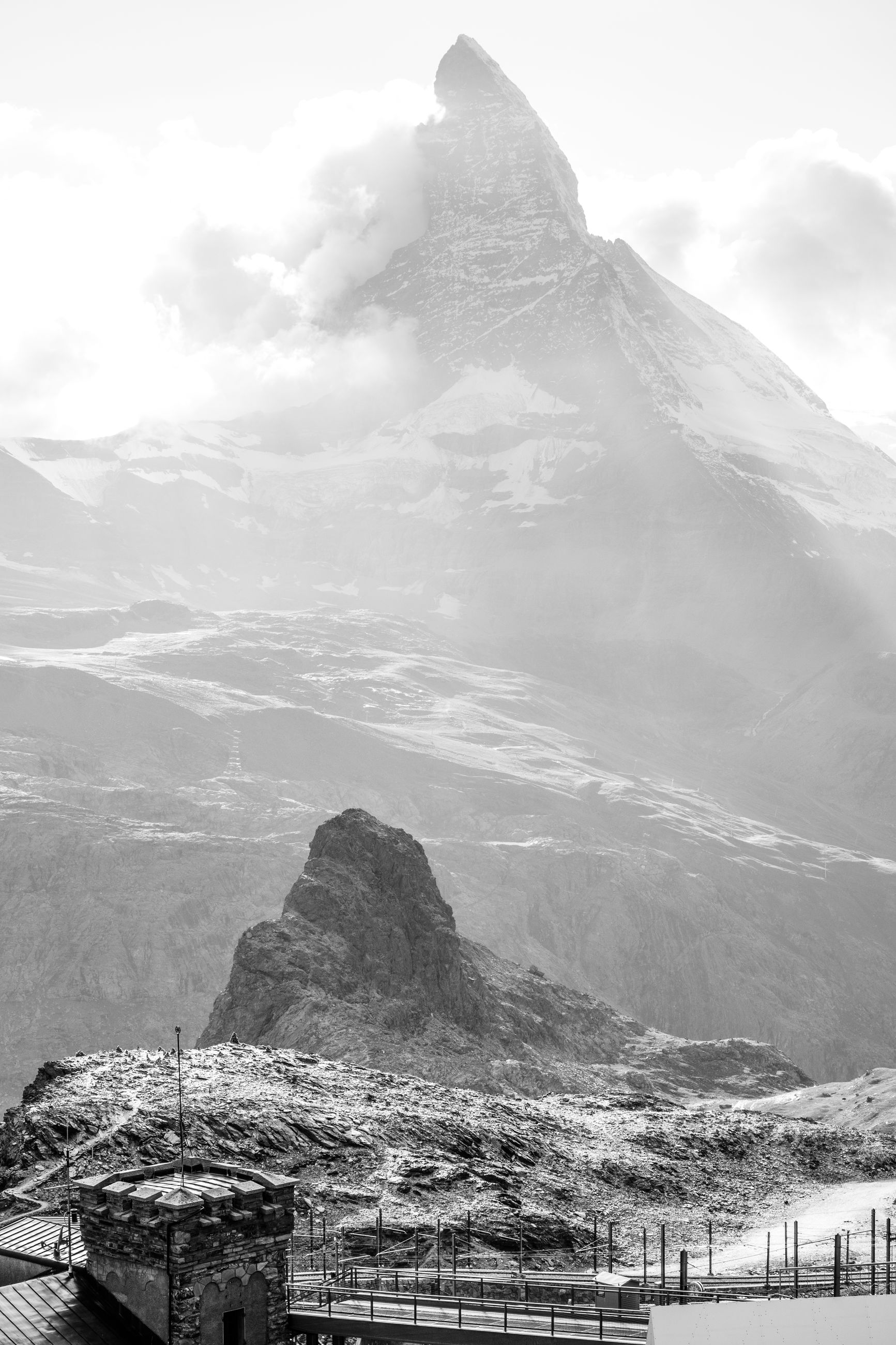 mountain, black and white, scenics - nature, monochrome photography, sky, beauty in nature, monochrome, environment, landscape, mountain range, nature, travel destinations, architecture, snow, water, land, travel, cloud, cold temperature, built structure, no people, tourism, sea, outdoors, building exterior, day, winter, building, tranquility, mountain peak, tranquil scene, snowcapped mountain, non-urban scene, white