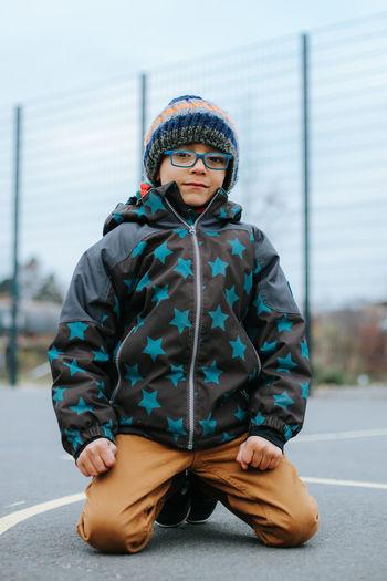 Portrait of boy wearing warm clothing in winter