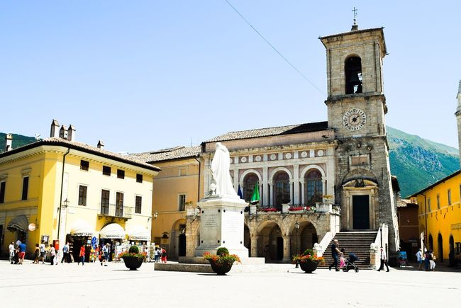 Architecture Blue Building Exterior Built Structure Church Clear Sky Day Façade Lifestyles Low Angle View Norcia Outdoors Place Of Worship Religion Sky Spirituality Sunlight Tourism Tourist Travel Destinations Umbria