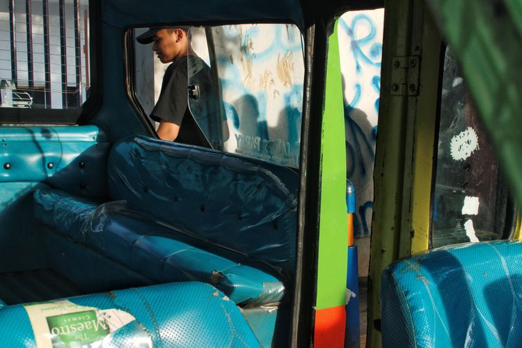 Somewhere in Bogor, Indonesia. December 2017 Streetphotography Documentaryphotography Local Transport Transportation Car City Transportation Green Street Scene UNPOSED Candid Window Only Men Adults Only One Person Adult One Man Only Day Outdoors Young Adult Real People People Men EyeEm Ready   The Street Photographer - 2018 EyeEm Awards