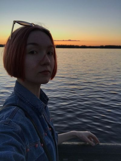 Water Sunset One Person Nature Outdoors Young Adult Young Women Real People Beautiful Woman Lake Lifestyles Leisure Activity Tranquility Beauty In Nature Sky Scenics Portrait Day People Sunset Silhouettes Sunset_collection Women Beauty In Nature Side View
