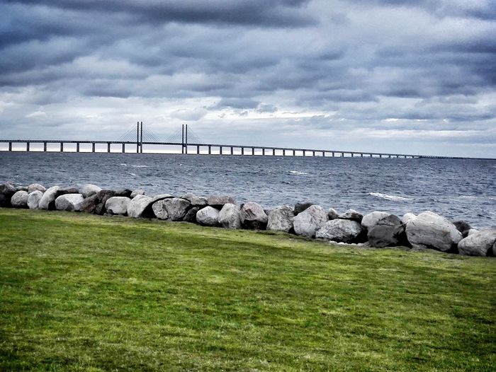 Bridge - Man Made Structure Connection Grass Water Stone - Object Sky Ocean Architecture Built Structure Rock - Object Cloud - Sky Sea Bridge Cloud Connection Bridge - Man Made Structure Grass Water Stone - Object Sky Ocean Built Structure Architecture Rock - Object Travel Destinations