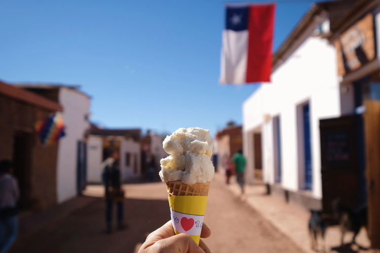 The Week On EyeEm Frozen Food Ice Cream Ice Cream Cone Food And Drink Dessert Day Human Hand Outdoors Focus On Foreground Sky Food at San Pedro De Atacama , Chile