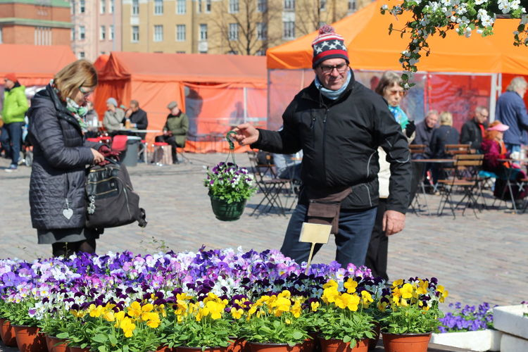 Pictures taken at Hakaniemi Market Hall, no editing, no touching. April 2016 Casual Clothing Day Enjoyment FIN Finnish Spring Flower Flower Shop Full Length Hakaniemen Kauppahalli Hakaniemi Hakaniemi Market Hall Hakaniemi Tori Helsinki Leisure Activity Lifestyles Outdoors Plant Portrait Upclose Street Photography Sitting Spring Flowers Traditional Clothing