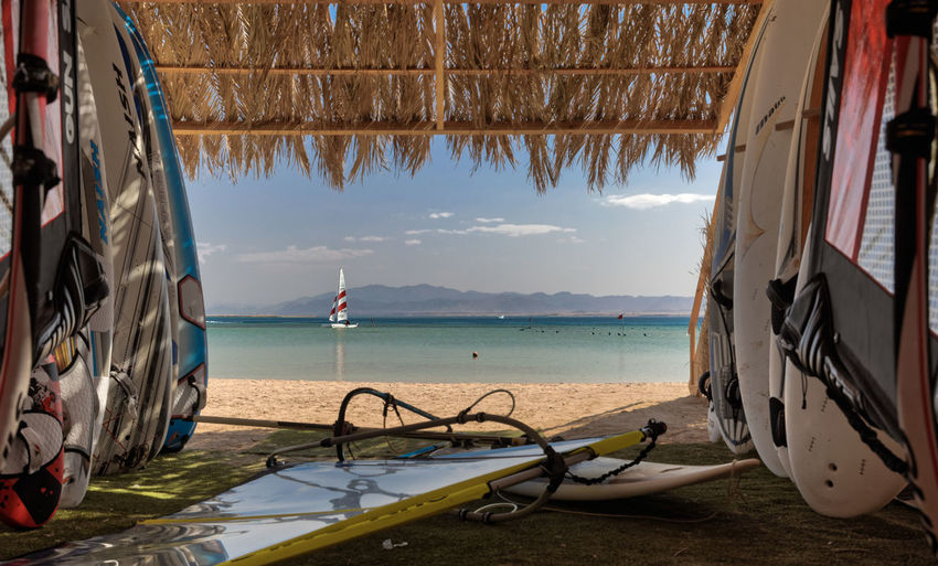 Window to Vacation! Catamaran Soma Bay Day Egyptian Mountain No People Palmlead Red Sea Memories Rigg Sea Sky Storage Surfboard Thatched Roof Vacation Destination Water Watersportsclub Windsurfing