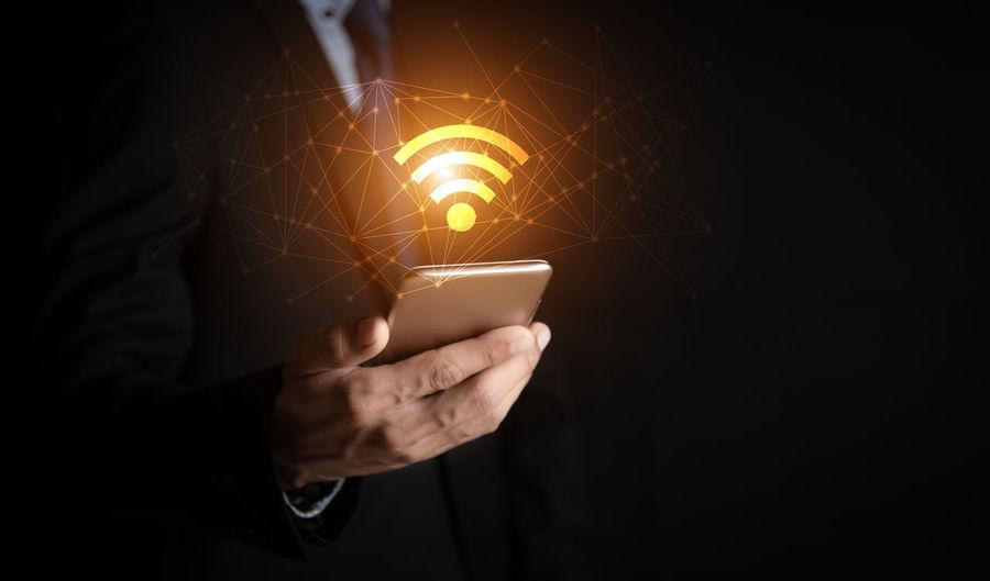 Man using smart phone at night