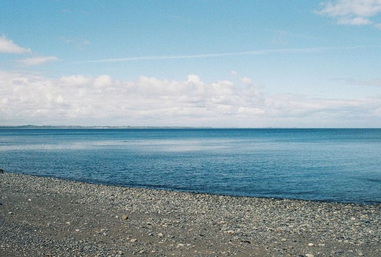Mar. Analogue Photography Water Sea Beauty In Nature Tranquility Sky Tranquil Scene Beach Cloud - Sky Horizon Over Water Horizon Blue