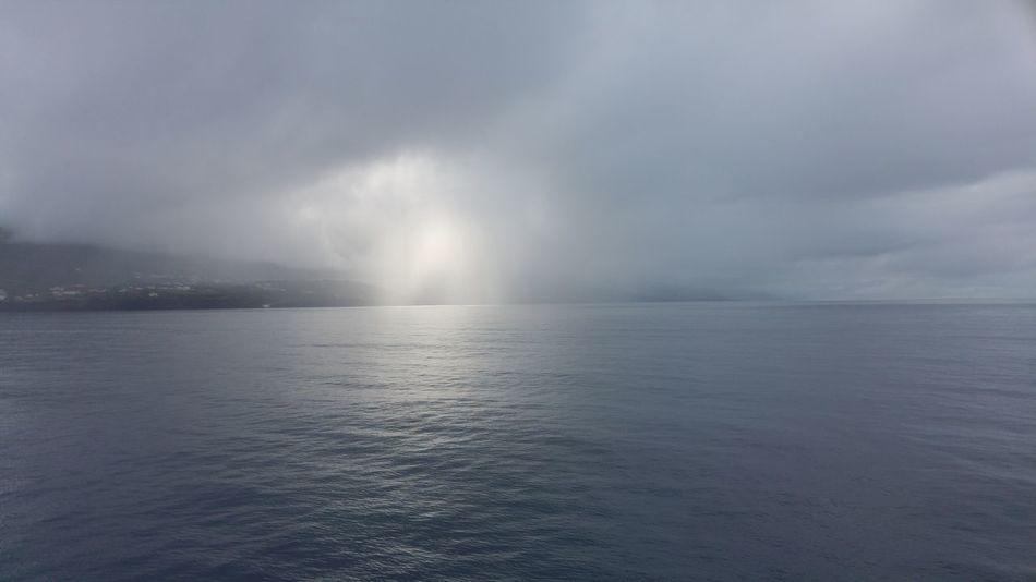 Atlantic Ocean Foggy Weather Sun And Fog Sao Jorge Island Early In The Morning Summer Coastline
