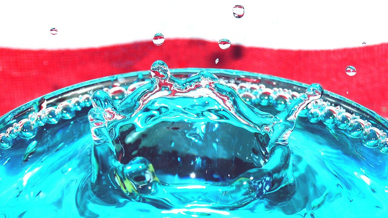 Close-Up Of Splashed Water In Drinking Glass