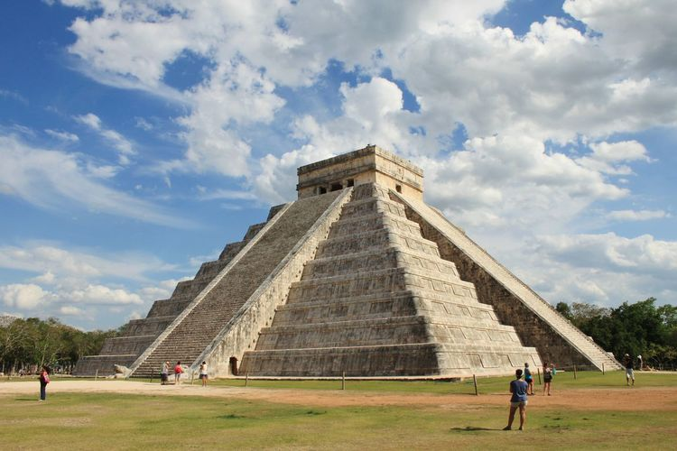 People At Kukulkan Pyramid Of Chichen Itza Against Sky