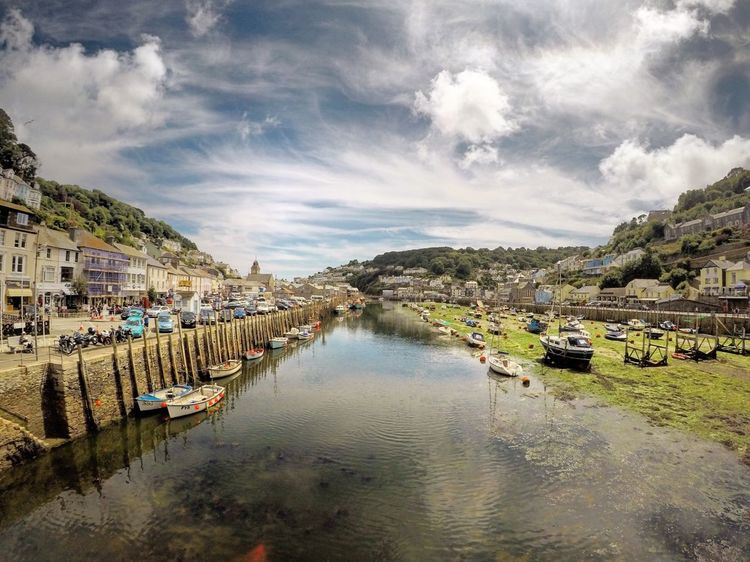 Water Building Exterior Sky Architecture Built Structure Cloud - Sky Outdoors Day Tranquil Scene River Nature Scenics Waterfront No People Tranquility Mountain Beauty In Nature Nautical Vessel Tree Estuary Estuary View Looe Looe Harbour Cornwall Uk