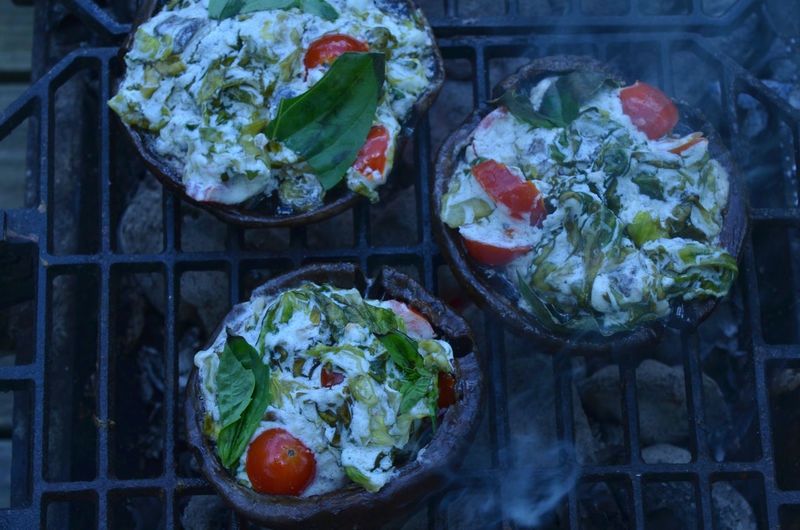 grilling stuffed Portobello mushrooms outdoors on Hibachi grill Close-up Day Food Food And Drink Freshness Grilled Mushrooms Grilled Portobello Grilled Vegetables Grilling Healthy Eating Mushrooms No People Portobello Mushroom Stuffed Mushrooms