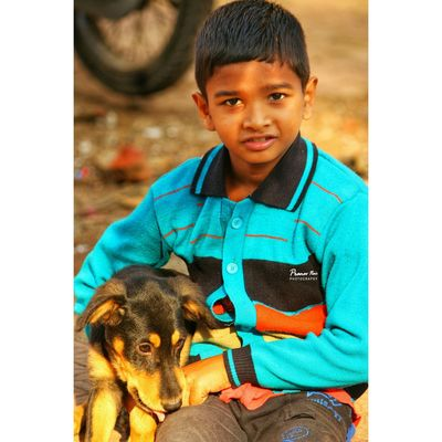 Dog Pets One Boy Only Child Cute Portrait One Person Happiness Smiling Wanderersoul Dombivli EyeEmNewHere EyeEm Masterclass EyeEm Selects EyeEmBestPics Eye4photography  The Week On EyeEm EyeEm Best Shots EyeEm Best Edits Front View Close-up Looking At Camera Indianphotographer Perspectives On Nature