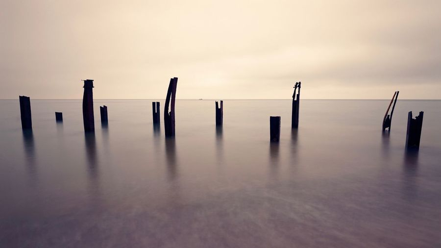 Long Exposure Wooden Post Post Sky Nature Water Sea Sunset In A Row