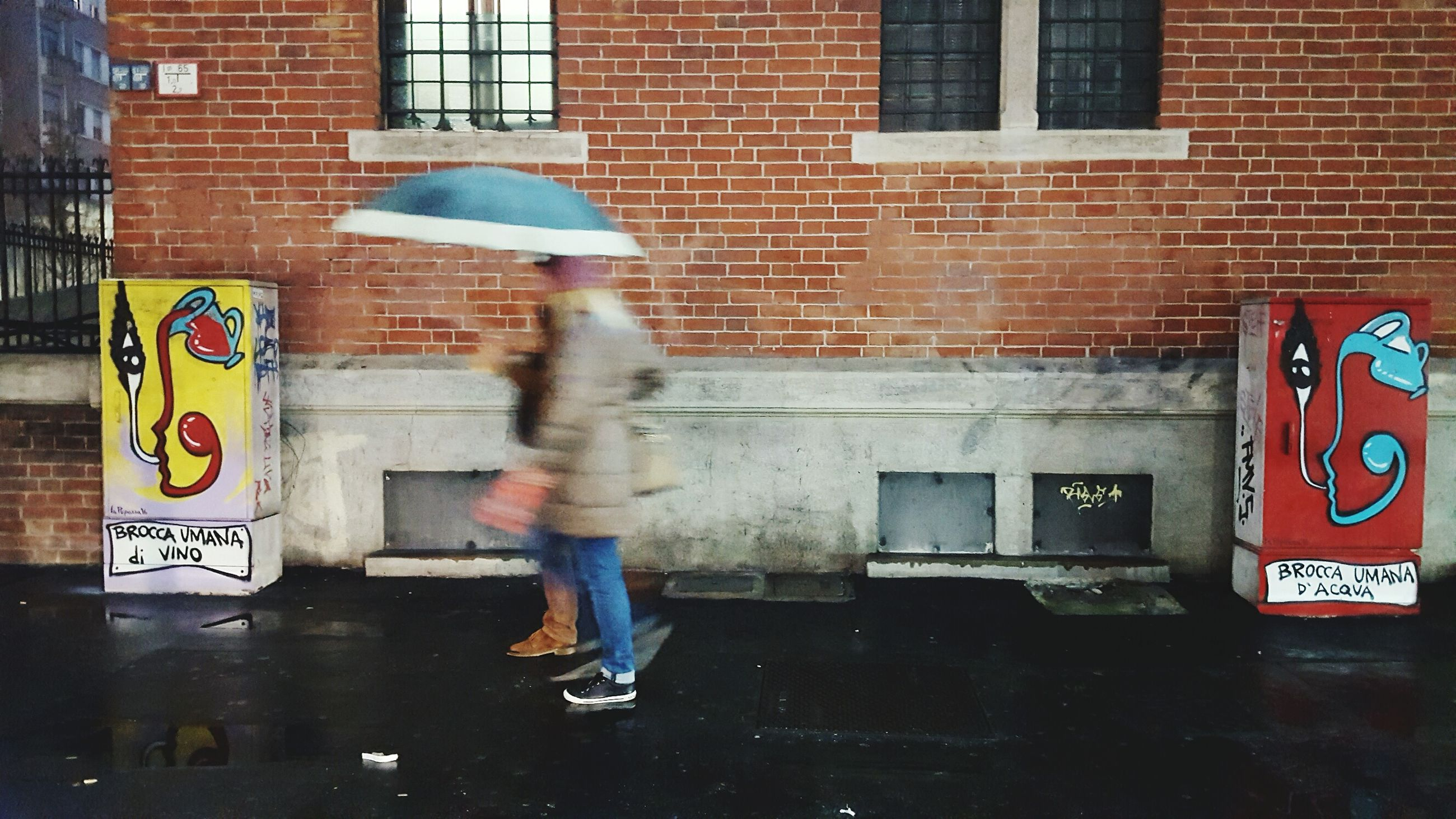 rain, wet, blurred motion, city, motion, child, walking, full length, one person, real people, people, urgency, day, outdoors, road sign, architecture, adult