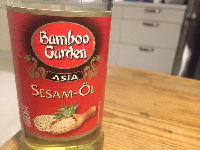 Berlin, Germany - January 31, 2018: Bottle of Bamboo Garden sesame oil Asian  Condiments  Cooking Diet Food And Drink Ingredients Isolated Sesam Close-up Condiment Delicious Dieting Dressing Food Food And Drink Gourmet Indoors  Ingredient Kitchen No People Oil Recipe Recipes Refreshment Restaurant