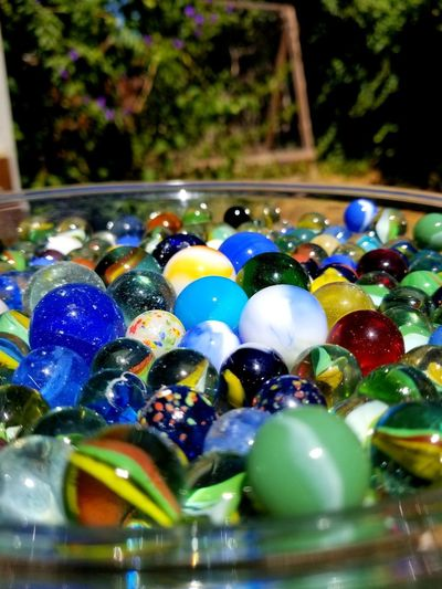 colorful marbles Shiny A Frame Vines Glass Bowl Back Yard Multi Colored Marbles Variation Close-up