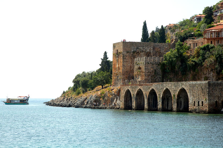 Old Shipyard Alanya Mediterranean  Mediterranean Sea Turkey Arch Bridge Architecture Building Exterior Built Structure Clear Sky Clear Water Emeraldcoast Historical History Mode Of Transportation Nature Nautical Vessel Sea Shipyard Sky Tourist Destination Transportation Travel Destinations Tree Water Waterfront