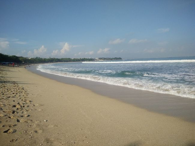 Wide view of Kuta Beach, Bali, Indonesia Beach Beauty In Nature Blue Calm Cloud Cloud - Sky Coastline Day Horizon Over Water Idyllic Nature No People Non-urban Scene Outdoors Remote Sand Scenics Sea Shore Sky Sunny Tranquil Scene Tranquility Water Wave