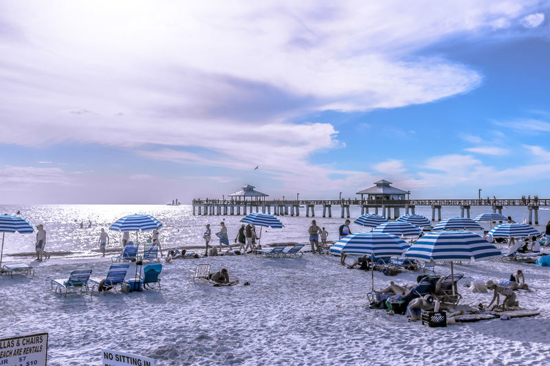 EyeEmNewHere Fort Meyers Beach Pier Beach Beauty In Nature Blue Cloud - Sky Day Florida Horizon Over Water Nature Outdoors Sand Scenics Sea Shore Sky Summer Sun Lounger Tranquil Scene Tranquility Vacations Water