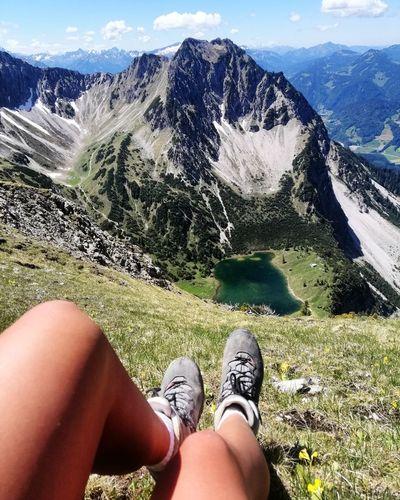 Women leg and mountains