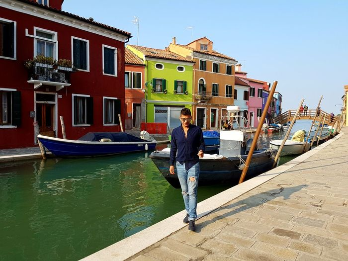 Burano, Italia Italia Burano Italy Close To Venice . Perfect Place For Pastel Colors And Blue Sky . Dolce Vita Colourful Colourful Houses Old Houses Full Length Vacations Building Exterior Architecture Sunlight Adult Adults Only Outdoors Water Nautical Vessel Summer Day One Man Only Travel Destinations People One Person Only Men Men Gondola - Traditional Boat Sky EyeEmNewHere Architecture