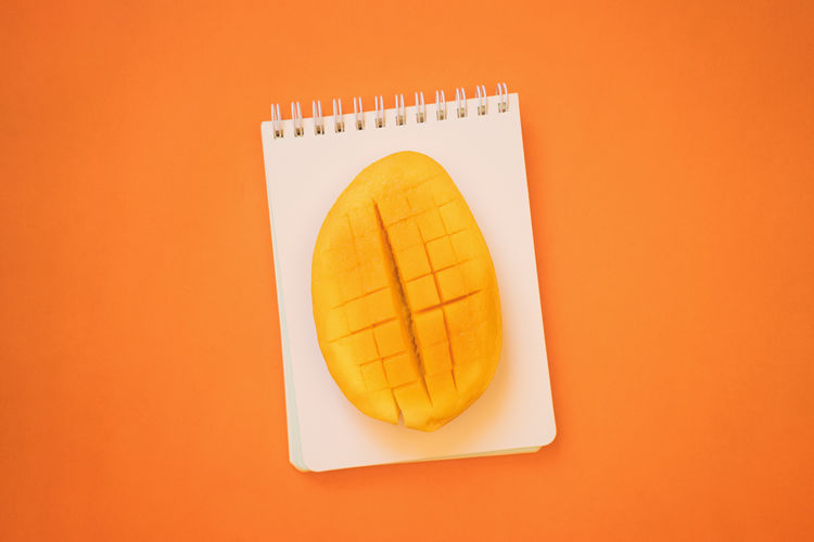 Close-up Colored Background Directly Above Food Food And Drink Freshness Fruit Healthy Eating High Angle View Mango Fruit Orange Color SLICE Still Life