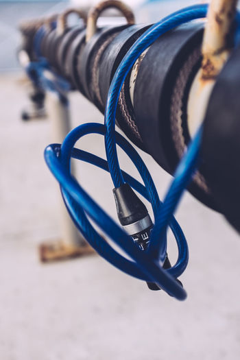 Close-Up Of Bicycle Lock On Rack