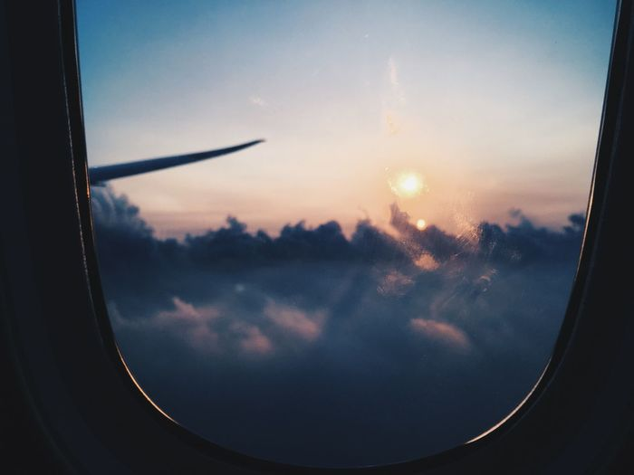 Window Mode Of Transport Transparent Vehicle Interior Transportation Glass - Material Airplane Air Vehicle Sunset Travel Cloudscape Sky Sun Cloud Flying On The Move Looking Through Window Scenics Cloud - Sky Sunlight