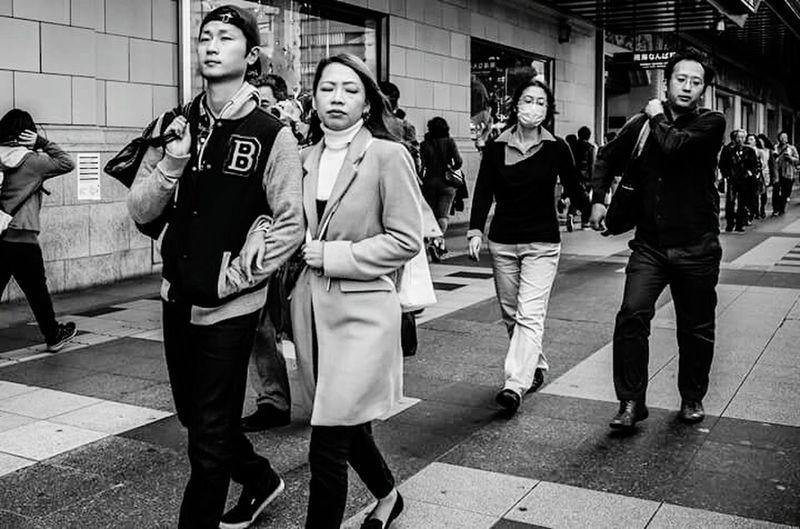 Women walking on sidewalk in city