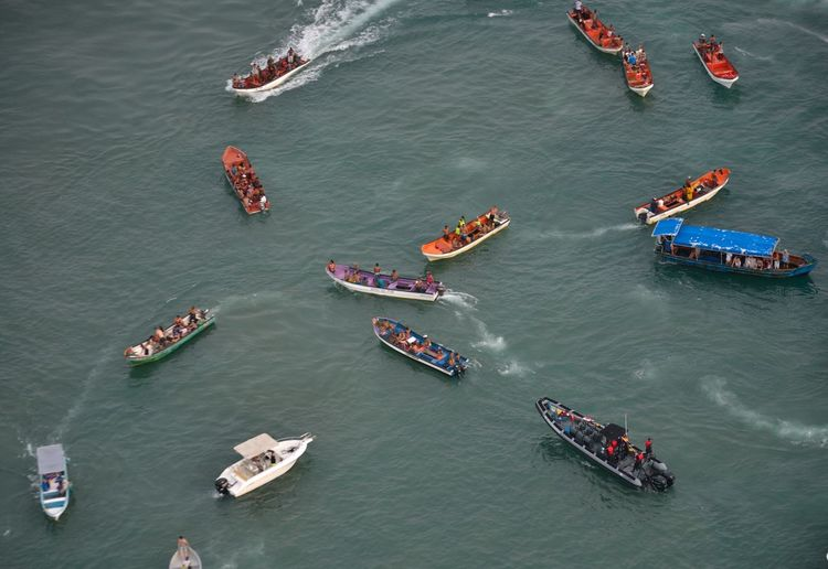 High angle view of people on boats in sea