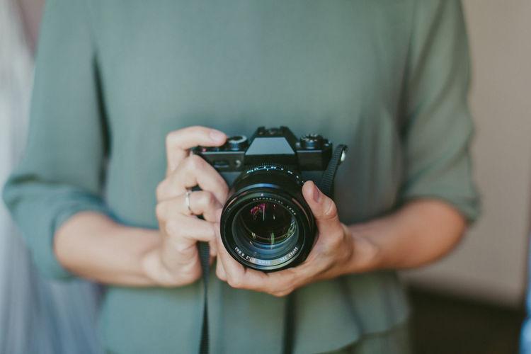 Man photographing camera