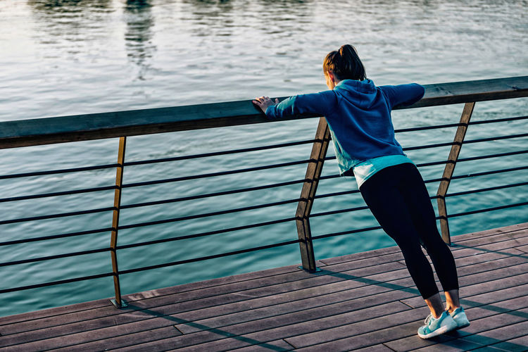City City Life Exercising Girl Power Lifestyle One Person Only Railing River View Riverside Woman Blue Fit Fitness Healthy Lifestyle Lifestyles One Person Outdoors Pushups Sporty Strength Urban Waterfront Fresh On Market 2018