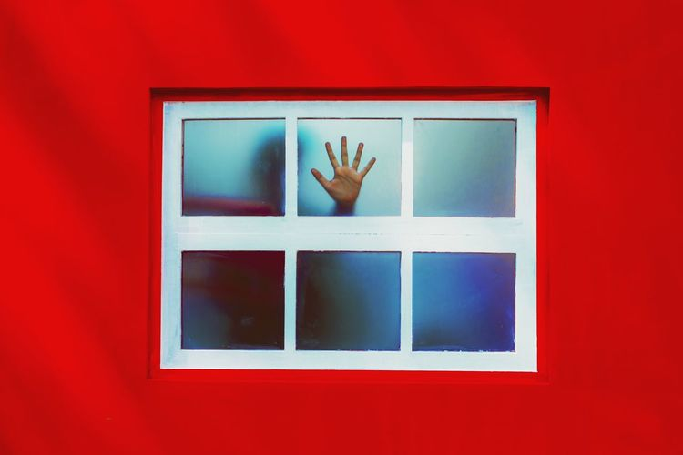 The hand on the window signifies that we need to stop when it's the correct time with red color