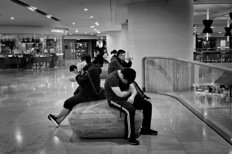People sitting in shopping mall