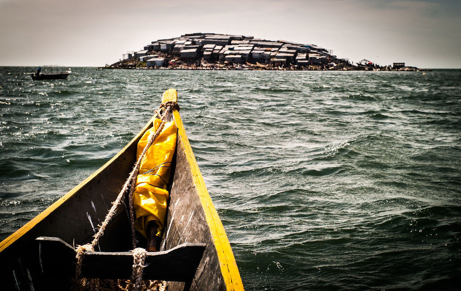 Migingo Island, Lake Victoria, Africa Been There. Done That. EyeEm Best Shots EyeEm Gallery EyeEmBestPics Grey Day Island View  Kenya Lost In The Landscape Migingo Island Paint The Town Yellow The Week On EyeEm Uganda  Corrugated Iron Fishing Boat Grey And Yellow Horizon Over Water Lake Victoria Needs Colours No People Poverty Slum The Island Water Yellow