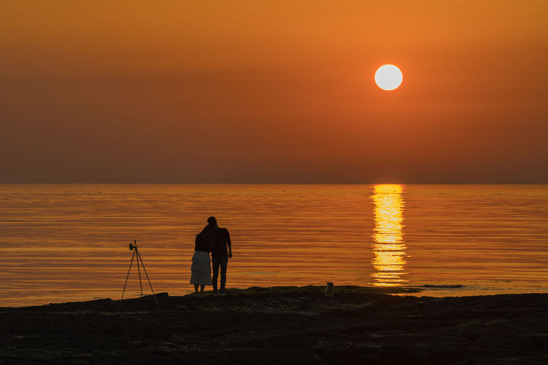 Two Lovers watching sun set of Jeju Island in Korea Sunset_collection Adult Beauty In Nature Full Length Horizon Over Water Nature Outdoors People Red Tone Scenics Sea Silhouette Sky Sunset Tranquil Scene Tranquility Two People Two Persons Water