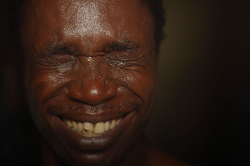 Close-Up Of Smiling Man With Sweat Covered Face