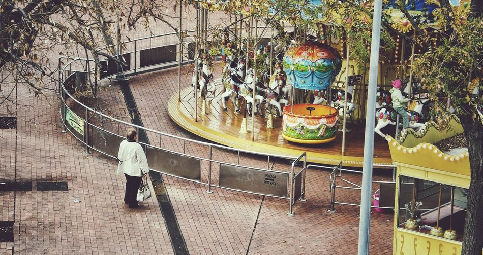 High angle view of woman at amusement park