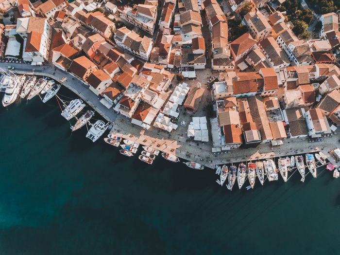 Aerial View Of Buildings And Boats Moored Over Sea