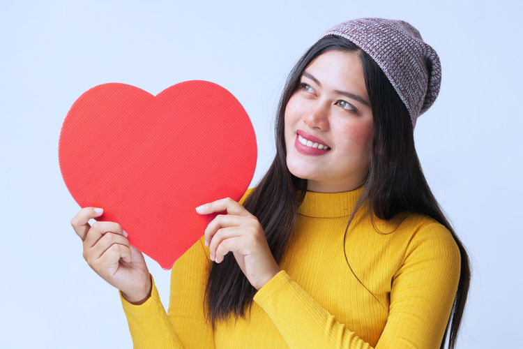 Positive Emotion Heart Shape Emotion Red Holding One Person Love Young Adult Smiling Young Women Happiness Front View Studio Shot Portrait Indoors  Headshot Women Hair Clothing Adult Valentine's Day - Holiday Hairstyle Beautiful Woman Teenager