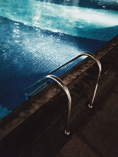 Close-up of sunglasses on swimming pool