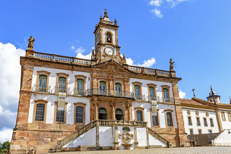 Old 18th century building in colonial architecture in the central square of the city of Ouro Preto in Minas Gerais Building Exterior Architecture Built Structure Sky History The Past Building Travel Destinations Window Day No People Travel Blue Tourism City Sunlight Façade Clock Tower Historic UNESCO World Heritage Site Colonial Architecture Baroque Style 18 Century Rococo 18th Century Style