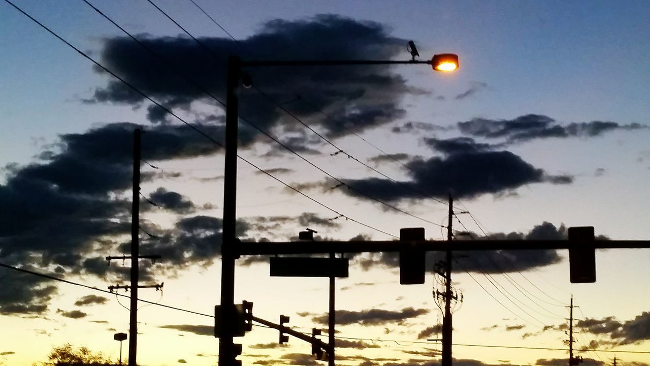 sky, illuminated, cable, street light, low angle view, sunset, no people, transportation, cloud - sky, dusk, outdoors, electricity, signal, railway signal, stoplight, nature, electricity pylon, technology, day