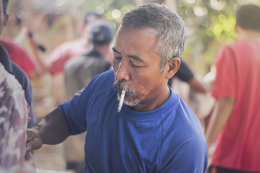Mr. Smokers INDONESIA Smoke Boys Casual Clothing Close-up Day Focus On Foreground Freshness Incidental People Leisure Activity Lifestyles Mature Adult Mature Men Men Nature Outdoors People Real People Togetherness