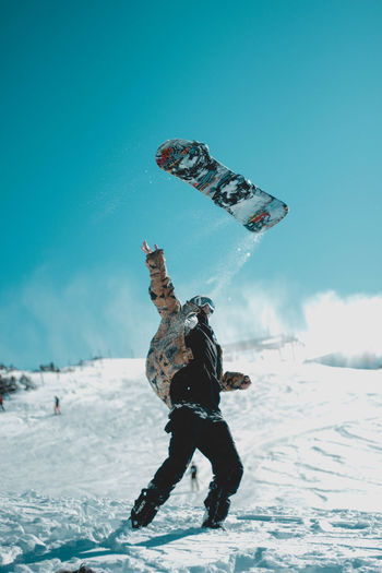 Just like to throw things in the air / Cold Temperature Extreme Sports Fun Leisure Activity Nature One Person Skill  Sky Snow Snowboarding Sport Weather Winter