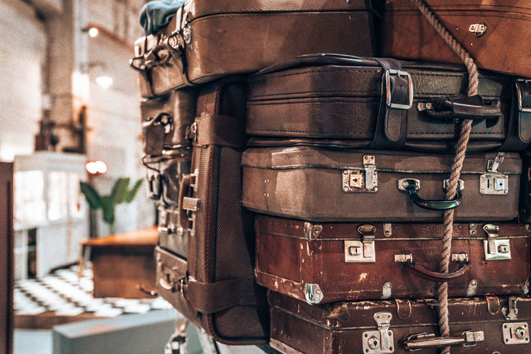 Vintage pile ancient suitcases form of tower design concept travel luggage