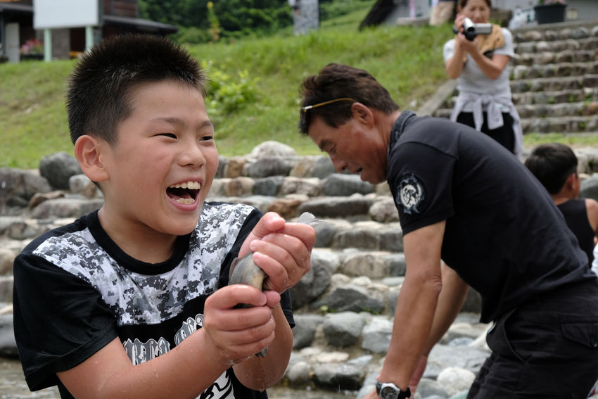 Fish Catching Bonding Boys Childhood Day Elementary Age Family Fun Happiness Leisure Activity Lifestyles My Son Nature Outdoors People Playing Real People Smiling Standing Togetherness Young Adult