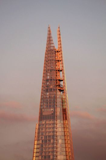 Low angle view of the shard against sky during sunset